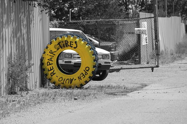 Photograph - Canary Yellow Tire Sign Selective Color by Colleen Cornelius