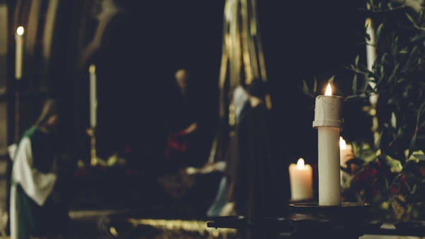 Photograph - Candles Light With Blurred Nativity Scene by Jacek Wojnarowski
