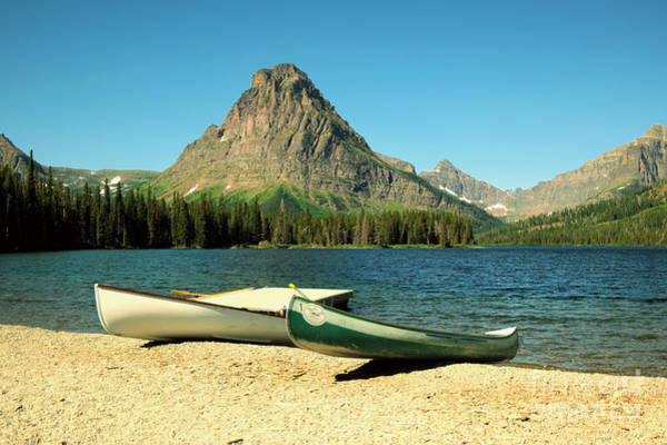 Swan Boats Photograph - Canoes Foreground Mount Sinopah by Jeff Swan