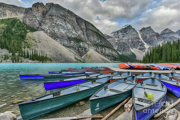 Moraine Lake Photograph - Canoes On Moraine Lake  by Paul Quinn