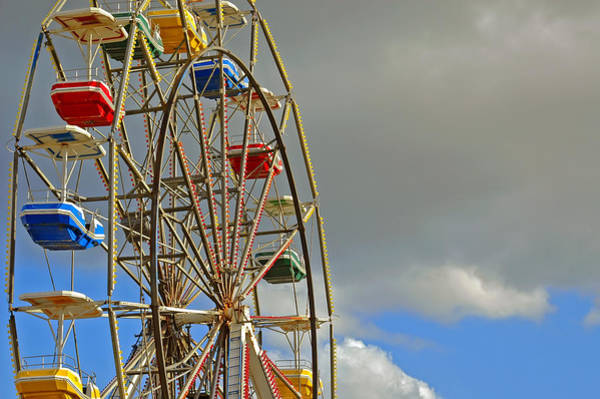 Photograph - Carnival Ride On Cloudy Day by Carolyn Marshall
