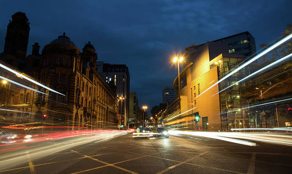 Greater Manchester Wall Art - Photograph - Cars In The Streets Of Manchester City by Michalakis Ppalis