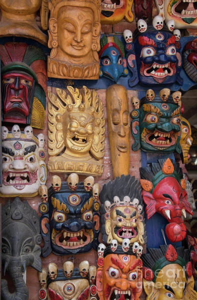 Wall Art - Photograph - Carved Hindu Masks On In Nepal  by Georgia Evans