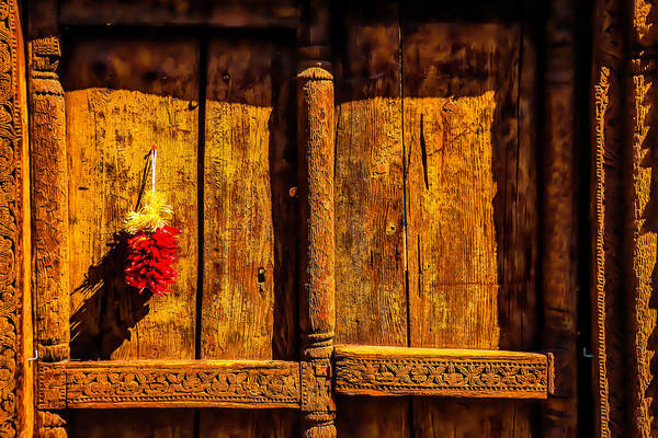 Wall Art - Photograph - Carved Wooden Door And Peppers by Garry Gay