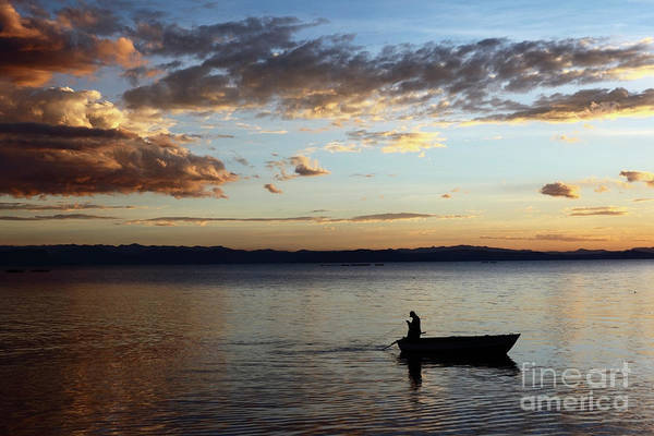 Photograph - Casting The Net On Lake Titicaca by James Brunker