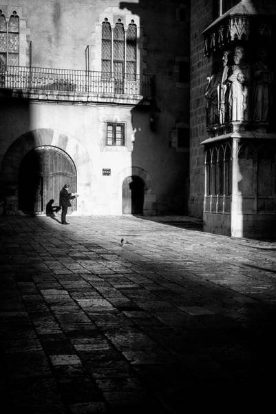 Photograph - Catching Up On The News In Tarragona Spain Bw by Joan Carroll