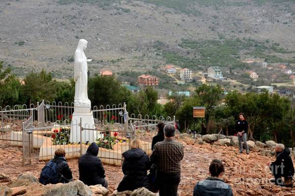 Photograph - Catholic Pilgrim Worshipers Pray To Virgin Mary Medjugorje Bosnia Herzegovina by Imran Ahmed