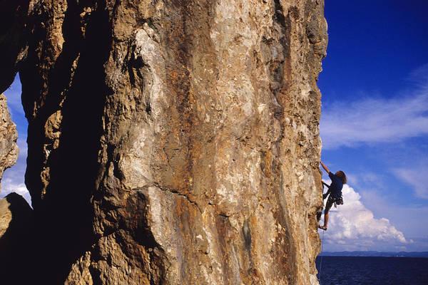 Hvar Wall Art - Photograph - Caucasian Male Rock Climbing by Bobby Model