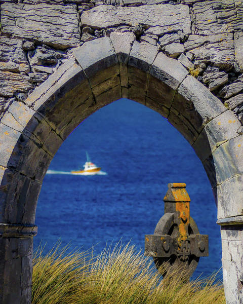 Photograph - Celtic Cross And Fishing Vessel From Isle Of Inisheer by James Truett