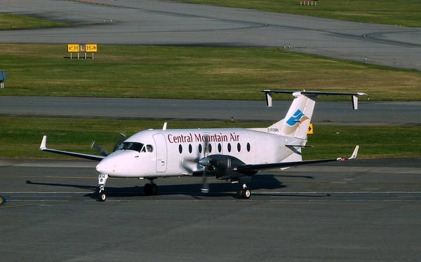Vancouver International Airport Wall Art - Photograph - Central Mountain Air Beech 1900d Taiis To The Active Runway by Darrell MacIver
