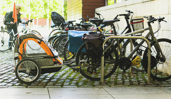 Photograph - Child Bike Trailers Parking On A Street by Jacek Wojnarowski