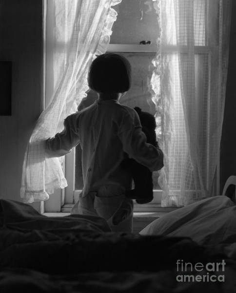 Wall Art - Photograph - Child Looking Out Window At Night by H. Armstrong Roberts/ClassicStock