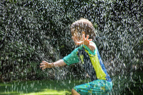 Photograph - Child Running Through The Water Sprinkler by Randall Nyhof