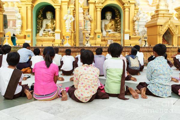 Reborn Wall Art - Photograph - Children Pray At Shwedagon Pagoda by Dean Harte