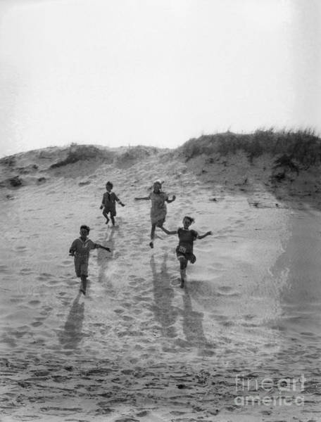 Photograph - Children Running Down Sand Dune, C.1920s by H Armstrong Roberts and ClassicStock