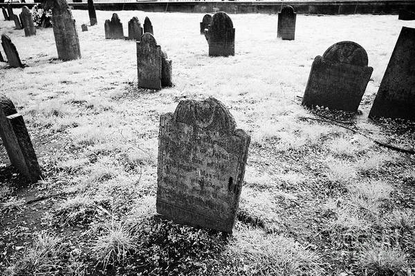 Wall Art - Photograph - childs grave and old headstones with winged angel decoration central burying ground cemetery Boston  by Joe Fox