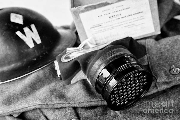 Wall Art - Photograph - Childs World War Two Gasmask And Air Raid Wardens Helmet Issued In Northern Ireland Uk by Joe Fox