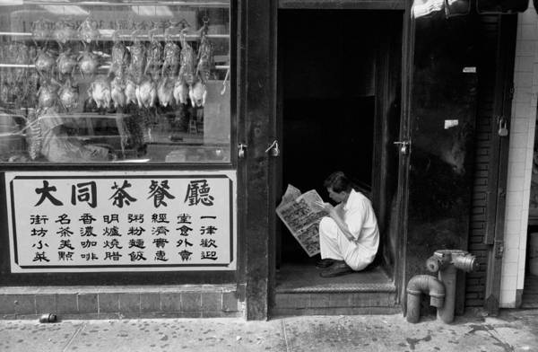 Photograph - Chinatown Newspaper Reader by Dave Beckerman
