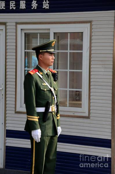 Photograph - Chinese Policeman Smartly Stands Guard In Beijing China by Imran Ahmed