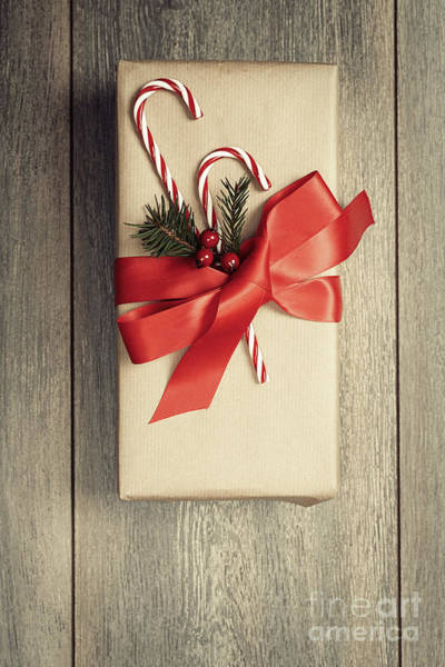 Gift Wrap Photograph - Christmas Gift With Candy Canes by Amanda Elwell