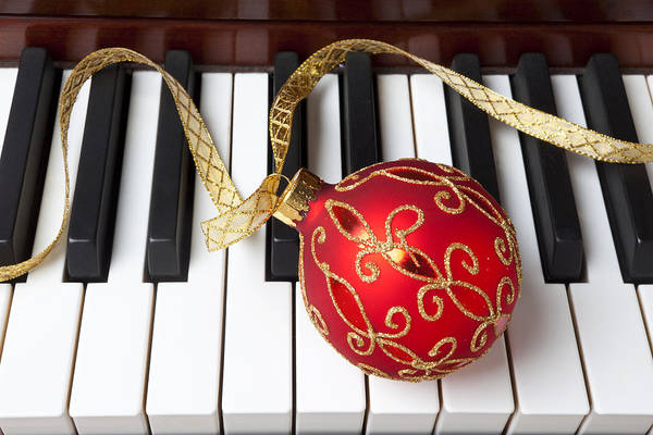 Keyboard Instrument Wall Art - Photograph - Christmas Ornament On Piano Keys by Garry Gay