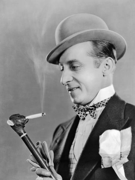Photograph - Cigarette Smoking Cane by Underwood Archives