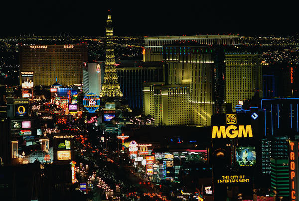 Grand Hotel Photograph - City Lit Up At Night, The Strip, Las by Panoramic Images
