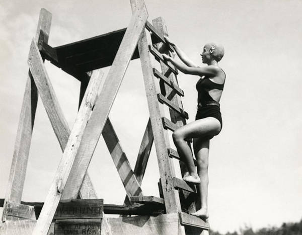 Diving Suit Photograph - Climbing Up The High Dive by Underwood Archives