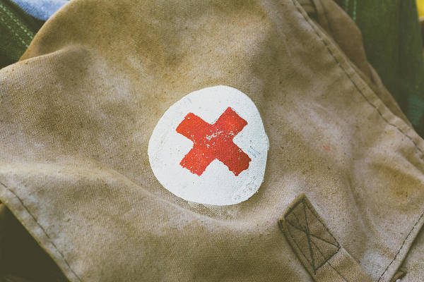 Photograph - Close Up Of Red Cross Vintage Bag by Jacek Wojnarowski