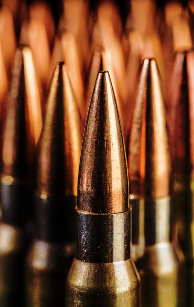 Photograph - Close Up Of Standing Rifle Bullets by Maggie McCall