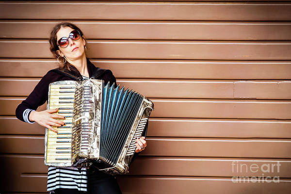 Photograph - Closed Shutter Serenade - Woman Play Accordion by Luca Lorenzelli
