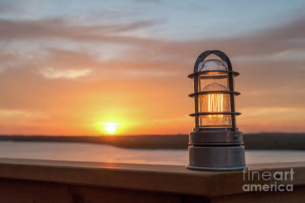 Closeup Of Light With Sunset In The Background Art Print