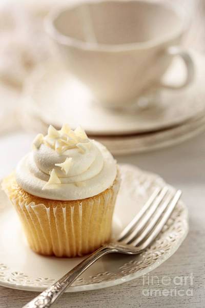 Photograph - Closeup Of Vanilla Cupcake With Tea Cup by Sandra Cunningham