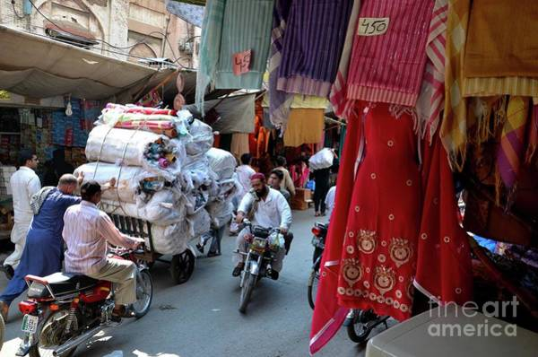 Coolie Photograph - Cloth Shops Inside Traditional Bazaar Market In Walled City Lahore Pakistan by Imran Ahmed