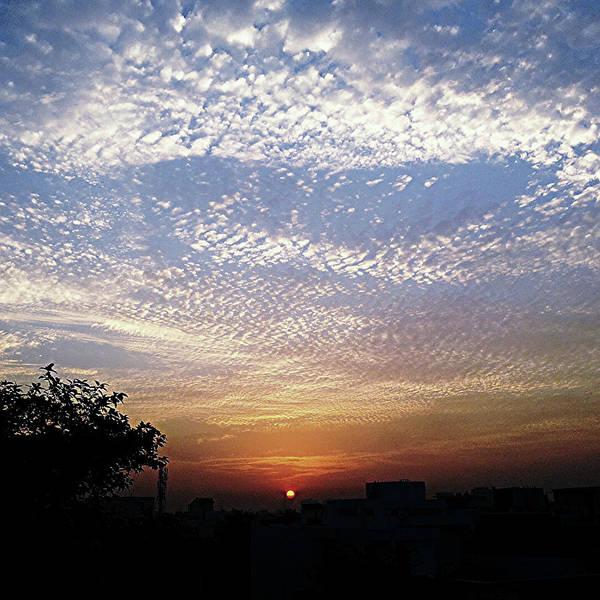 Photograph - Cloud Swirl At Sunrise by Atullya N Srivastava