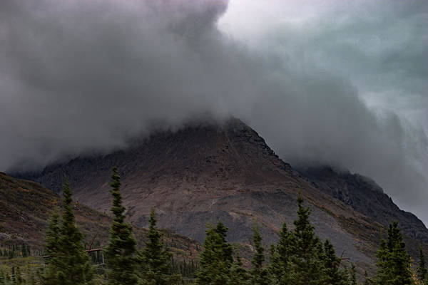 Photograph - Clouds Envelope Peaks by Jeff Folger
