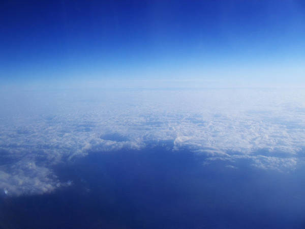Photograph - Clouds From The Plane Vi by Emiliano Giardini