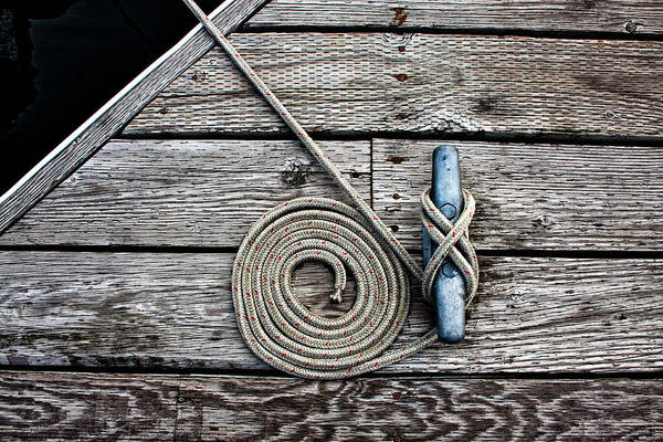 Wall Art - Photograph - Coiled Mooring Line And Cleat by Carol Leigh