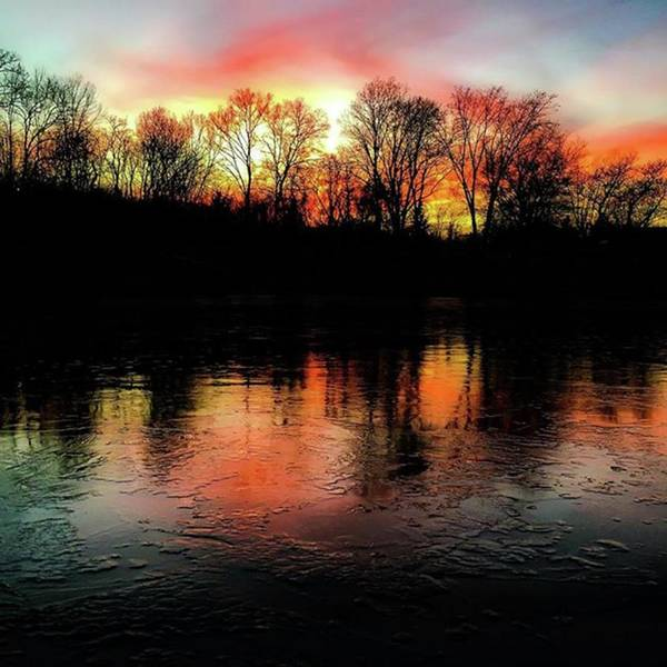 Wall Art - Photograph - A Frozen Lake Relect The Bold Setting Sun Colors  by Phunny Phace