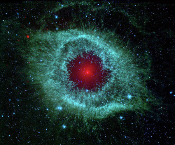 Photograph - Comets Kick Up Dust In Helix Nebula  by NASA Hubble Space Telescope