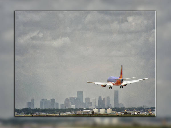 Photograph - Commercial Airliner Landing In Houston Hobby by Charles McKelroy