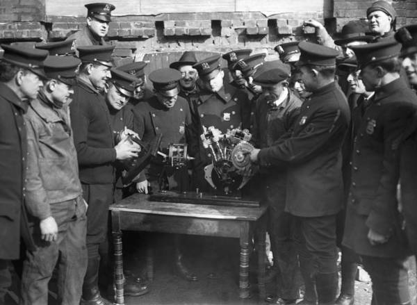 1921 Photograph - Cops Learn Motorcycle Engines by Underwood Archives