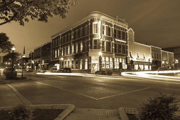 Corner Shop Wall Art - Photograph - Corner View In Sepia- Downtown Bentonville Arkansas Town Square At Night by Gregory Ballos
