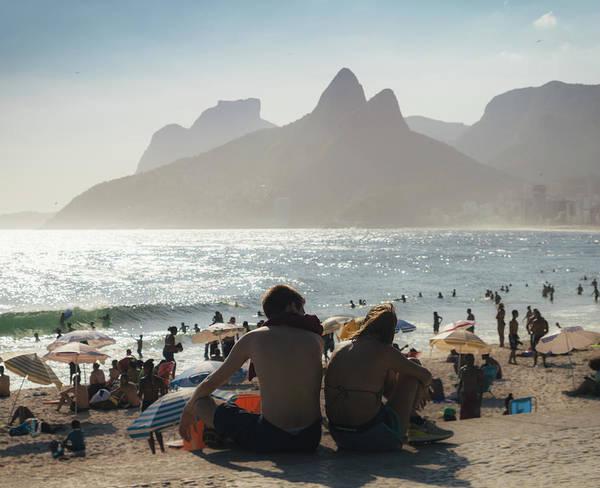 Photograph - couple at Ipanema Beach in Rio de Janeiro, Brazil by Alexandre Rotenberg