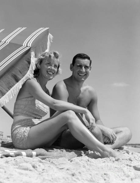 Photograph - Couple At The Beach, C.1950s by H. Armstrong Roberts/ClassicStock