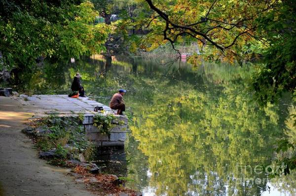 Photograph - Couple Sit Quietly On Jetty And Fish At A Lake Outside Beijing China by Imran Ahmed