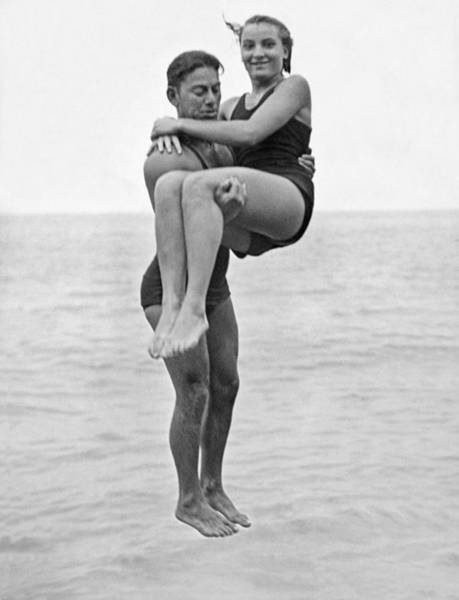 Diving Suit Photograph - Couple Tandem Leaps Into Lake by Underwood Archives