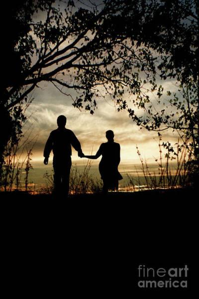 Photograph - Couple Walking At Sunset by Clayton Bastiani