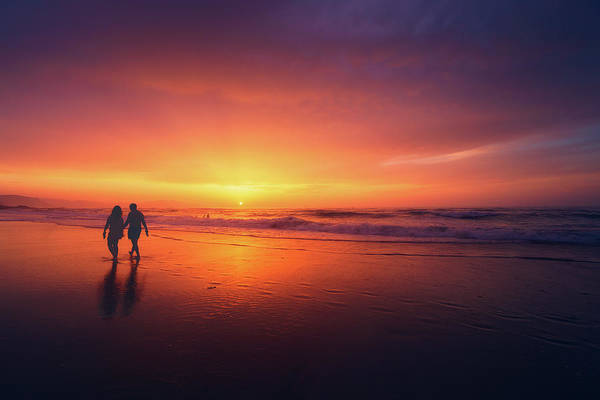 Wall Art - Photograph - Couple Walking On Beach At Sunset by Mikel Martinez de Osaba