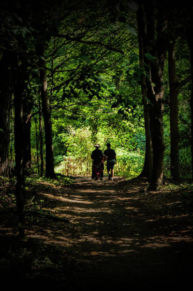 Photograph - Couple Walking Towards The Light Through A Forest Path Tunnel by Randall Nyhof